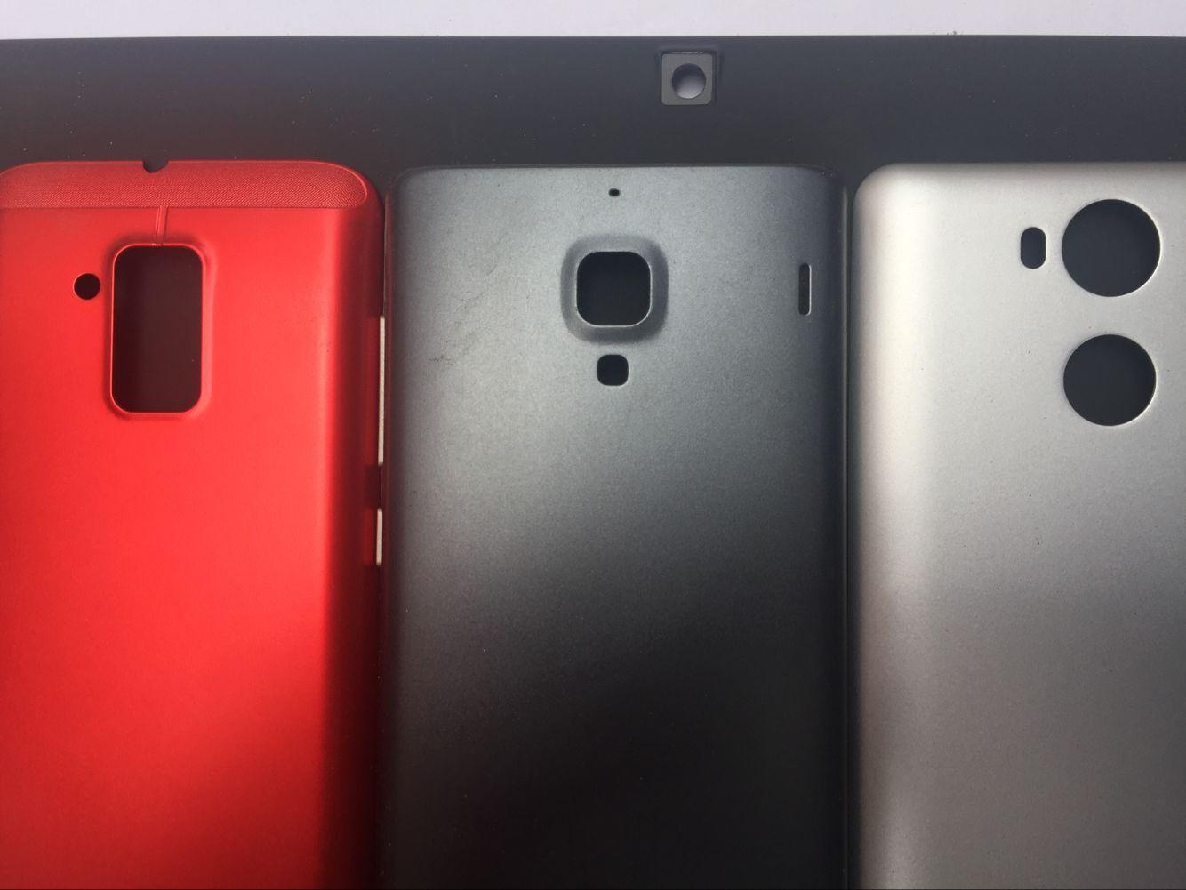 手机壳加工 手机护套加工 手机LOGO精雕加工 深圳手机贴镍片,手机护套锣孔加工