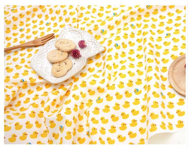 卡通纯棉面料儿童服装小黄鸭围裙床品卡通宝宝口水巾