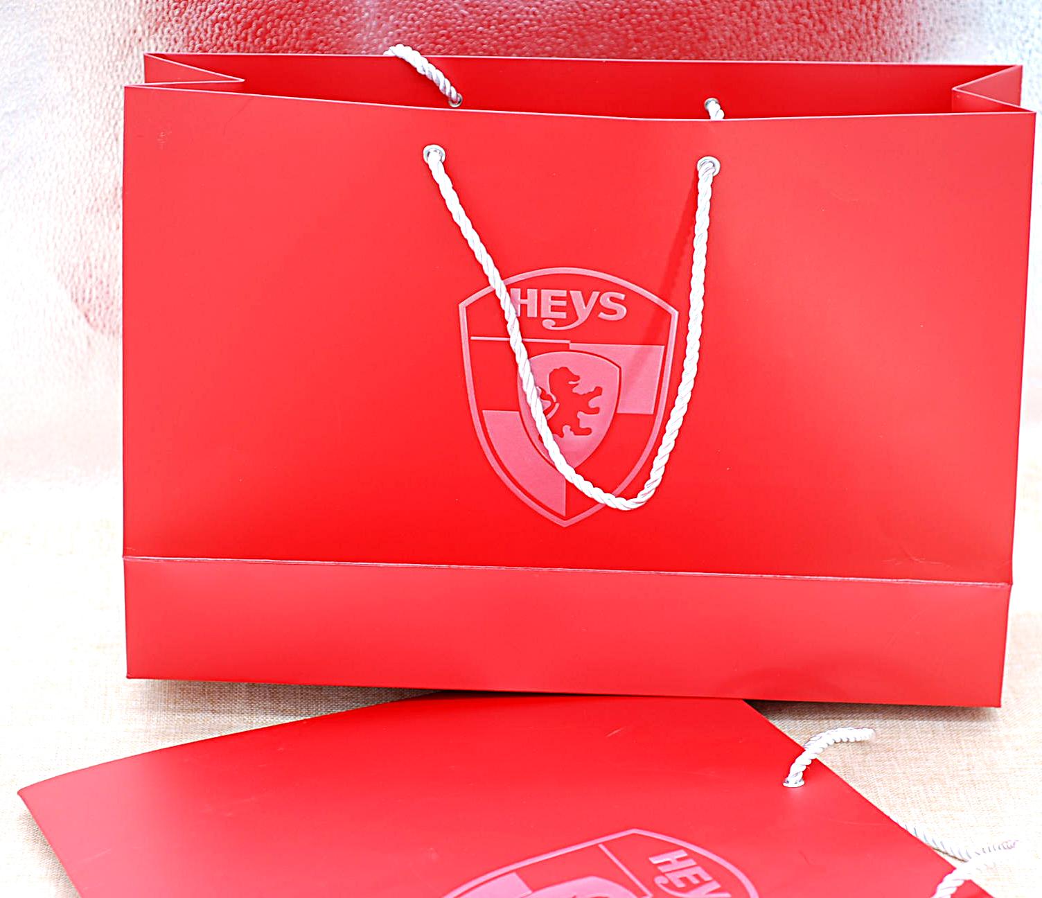 厂家直销供应印刷 高档 服装纸袋 定做购物袋白卡包装礼品手提袋 手提袋加工